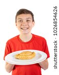 Young caucasian teenage boy with a cornish pasty on a plate - stock photo