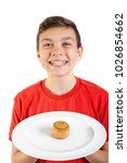 Young caucasian teenage boy with a pork pie on a plate - stock photo