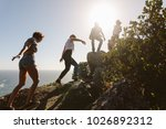 group of friends on a mountain. ... | Shutterstock . vector #1026892312