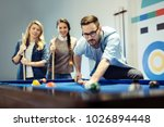 cheerful business team playing... | Shutterstock . vector #1026894448