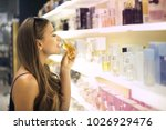 trying different perfumes | Shutterstock . vector #1026929476