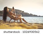 texting at the beach | Shutterstock . vector #1026930562