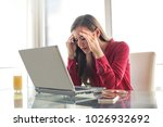 stressed woman at work | Shutterstock . vector #1026932692