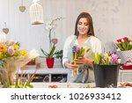 smiling woman florist small...   Shutterstock . vector #1026933412