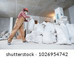 worker collecting construction... | Shutterstock . vector #1026954742