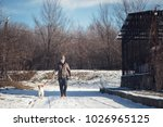 young dog instructor walking a... | Shutterstock . vector #1026965125