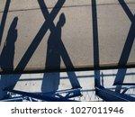 shadow of a cyclist on asphalt | Shutterstock . vector #1027011946