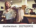 woman in hair salon getting her ... | Shutterstock . vector #1027020952