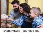 happy family at animal shelter... | Shutterstock . vector #1027021402