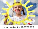 Happy summer - lovely girl painting sun on sky - stock photo