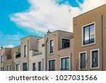 some townhouses in a row at... | Shutterstock . vector #1027031566