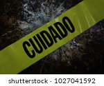 yellow cuidado  caution  tape... | Shutterstock . vector #1027041592