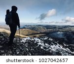 one man with walking sticks... | Shutterstock .eps vector #1027042657