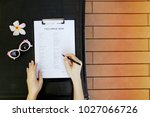 Small photo of sunny flat lay of woman fill visa application for travel, sunlight portrait with sunglasses. and flower. concept of traveling journey agencies, tourist agency. Front used with Open Font License