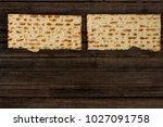 two pieces of matzah or matza... | Shutterstock . vector #1027091758