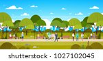people in park relaxing in... | Shutterstock .eps vector #1027102045