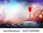 close up shot red dart arrow on ... | Shutterstock . vector #1027104982