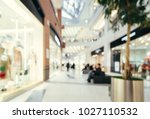 shopping mall blur background... | Shutterstock . vector #1027110532