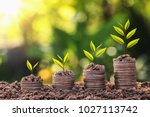 plant growing on coin stack... | Shutterstock . vector #1027113742