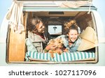 hipster couple with cute dog... | Shutterstock . vector #1027117096