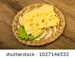 sliced cheese with salad leaves ...   Shutterstock . vector #1027146532