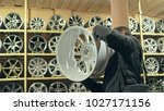the man buys alloy wheels in... | Shutterstock . vector #1027171156