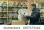 the man buys alloy wheels in... | Shutterstock . vector #1027171162