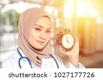 medical staff and clock with... | Shutterstock . vector #1027177726