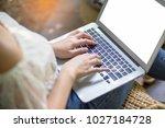 women typing keyboard laptop... | Shutterstock . vector #1027184728