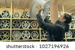 the man buys alloy wheels in... | Shutterstock . vector #1027196926