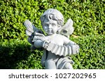 Cupid statue playing accordian...