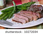 Juicy Tender Grilled Beef Ribeye with Asparagus and Herb Seasoning - stock photo