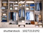 big wardrobe with male clothes... | Shutterstock . vector #1027213192