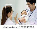 asian pediatrician is taking...   Shutterstock . vector #1027217626