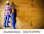 people on a consruction site   Shutterstock . vector #1027219492
