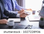 men working at table in office  ... | Shutterstock . vector #1027228936