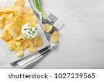 potato chips and sour cream... | Shutterstock . vector #1027239565