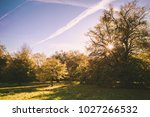 classic autumn view in a park... | Shutterstock . vector #1027266532