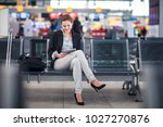 young female passenger at the... | Shutterstock . vector #1027270876