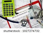 stethoscope and calculator... | Shutterstock . vector #1027276732