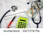 stethoscope and calculator... | Shutterstock . vector #1027276756
