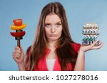 woman girl holding vitamin... | Shutterstock . vector #1027278016