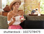 happy female in straw hat and... | Shutterstock . vector #1027278475