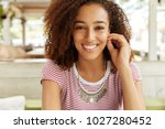 headshot of positive good... | Shutterstock . vector #1027280452