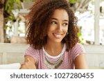 pleased african american female ... | Shutterstock . vector #1027280455