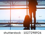 silhouette woman travel with... | Shutterstock . vector #1027298926