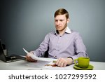 businessman reading agreement... | Shutterstock . vector #1027299592