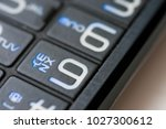 numbers and letters on an old... | Shutterstock . vector #1027300612