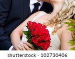 Bride and groom kiss in outdoor scenery - stock photo