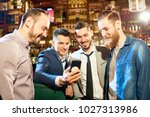 group of cheerful friends... | Shutterstock . vector #1027313986